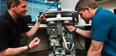 men working on a mechanical device