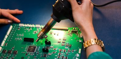 person working on a circuit board